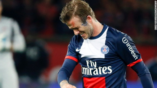 The emotion shows as David Beckham walks off the field during his final professional match.