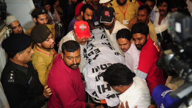 Pakistani rescuers carry Hussain's body on May 18 after she was killed in what was described as an execution-style attack.