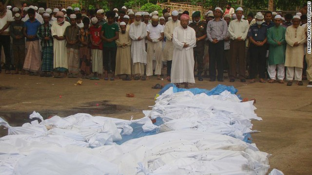 Bangladeshi men pray in front of the bodies of victims of Cyclone Mahasen in Tekna, south of Dhaka, on Friday, May 17. The bodies washed up on the shores of Bangladesh after the victims' boat capsized while sailing from Myanmar. At least 12 deaths have been reported in Bangladesh due to the cyclone.