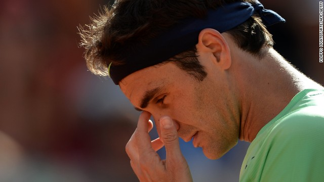 A dejected Roger Federer slips to a straight sets defeat to Nadal in the Rome Masters final.