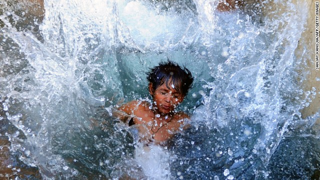 An boy cools off in a watering hole in Allahabad, India, on Saturday, May 18, where temperatures have reportedly reached 117.1 degrees Fahrenheit.