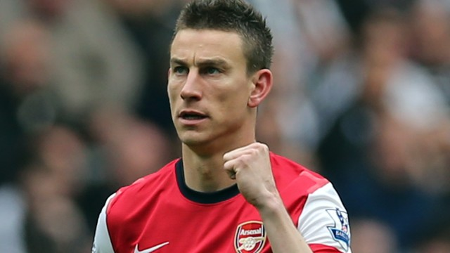 Laurent Koscielny celebrates his vital winner for Arsenal at Newcastle as they clinched fourth spot in the EPL.