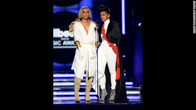 Presenters Erykah Badu and Janelle Monae speak onstage.