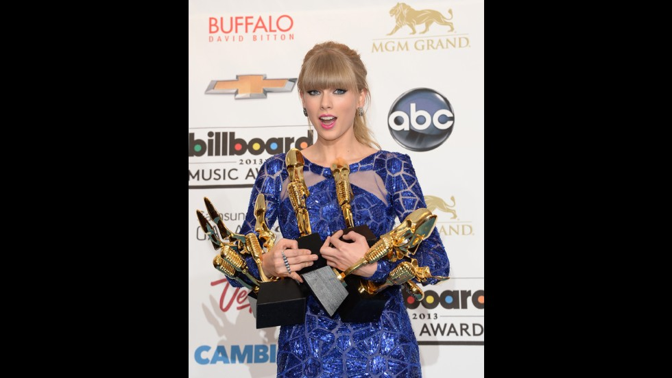 Taylor Swift poses with her Billboard awards.