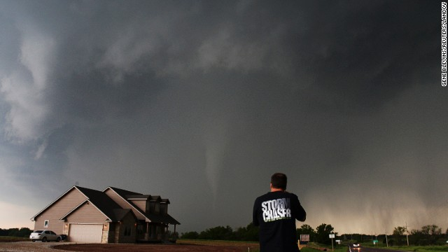 Storm chaser and videographer Brad Mack records a tornado touchdown in South Haven, Kansas, on May 19.
