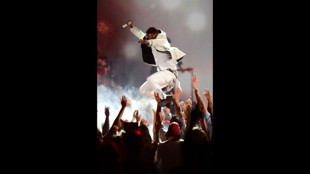 Miguel performs. See him accidentally land on a fan after his jump.