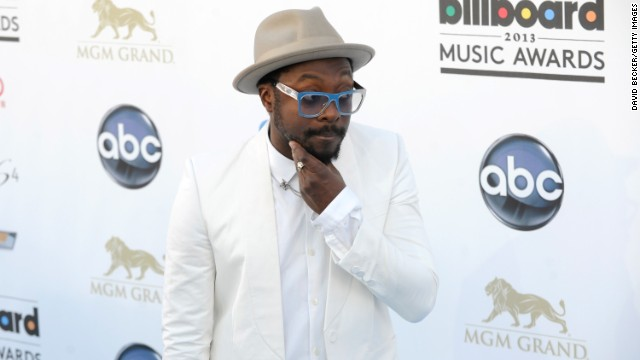 Will.i.am arrives.