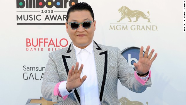Psy arrives.
