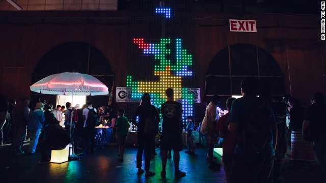 Visitors play a giant game of Tetris in the dark on this display from Oakland's Funhouse Productions.