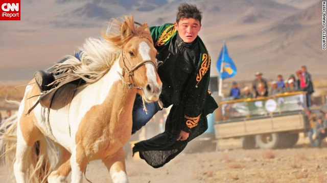 In a traditional sport, Mongolian riders try to find and pick up a coin from the ground without falling off their galloping horse. See more photos and learn about the event on CNN iReport.