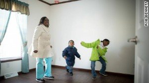 Affordable Housing Alliance beneficiaries Kaneisha Wilson and her two children set foot in their new home for the first time. The displaced family\'s Beachwood, New Jersey, property suffered extensive damage during Hurricane Sandy.