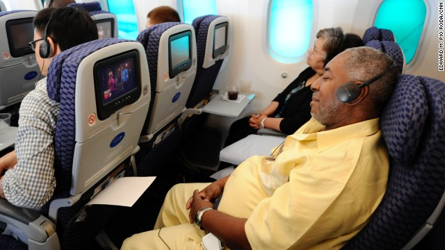 Michael Reynolds of St. Louis, Missouri, reclines during the flight to Chicago.