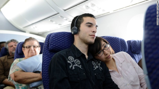 Alex Gilbert and Rebecca Davila watch a film during a flight on a Boeing 787 Dreamliner.