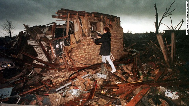 Peggy Lipscomb salvages belongings from what is left of her home in southeast Oklahoma City on May 4, 1999, following a series of deadly tornadoes that tore through the state.