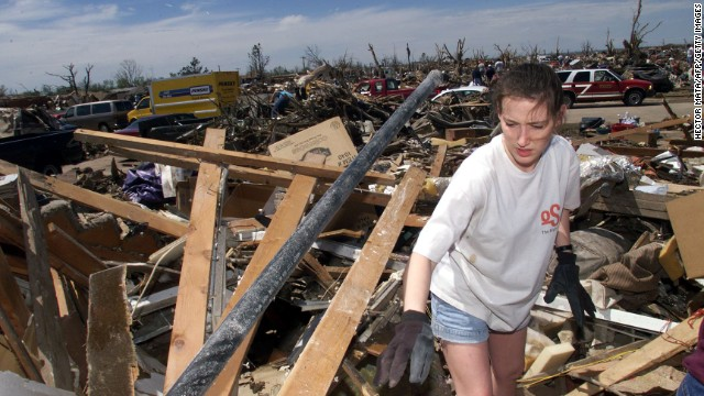 Amber Landis walks among the remains of her home in Moore, Oklahoma, which was destroyed by an EF5 tornado on May 3, 1999. Forty-six people were killed in a <a href='http://www.cnn.com/2013/05/20/us/oklahoma-1999-tornado/index.html'>string of tornadoes</a> that tore through Oklahoma on May 3, 1999, the strongest of which was an EF5 that hit the towns of Moore, Bridge Creek, Newcastle, Midwest City and Del City. Now this section of the country is dealing with <a href='http://www.cnn.com/2013/05/20/us/severe-weather/index.html?hpt=hp_t1'>a fresh disaster that has eclipsed the 1999 outbreak</a>. Click through the gallery to see more pictures from 1999: