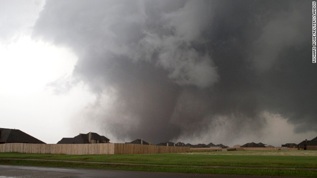 A massive tornado approaches Moore on May 20. The storm first touched down to the west of the city near Newcastle, Oklahoma. Visit CNN.com/impact for ways to help the victims.