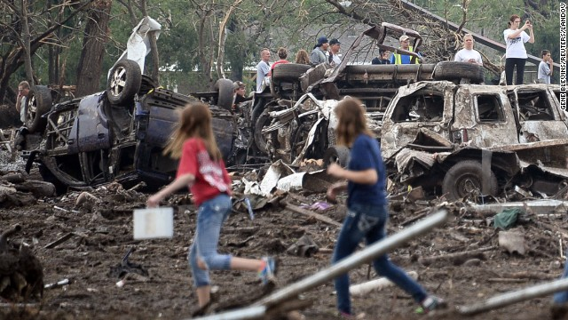 People look through the wreckage of their neighborhood after a tornado struck Moore, Oklahoma, on May 20.