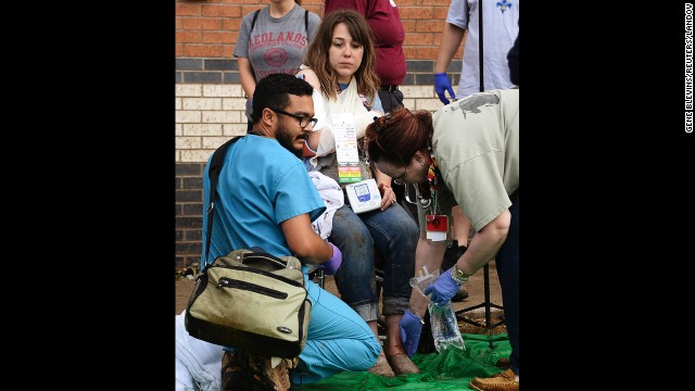 A woman is treated for her injuries on May 20 at a triage area set up for the wounded.