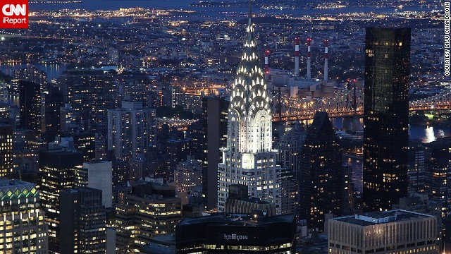 The art deco Chrysler Building shines brightly in the New York skyline in this view from the Empire State Building.