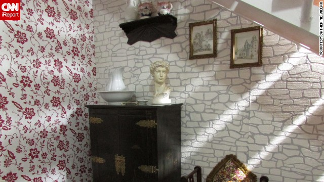 "<a href='http://ireport.cnn.com/docs/DOC-947832'>Catherine Villar</a>, in Montevideo, Uruguay, really loves wallpaper. ""It is amazing how they can transform a space,"" she said of the decor choice. This wallpaper is a kind you can paint over, she said. She used it to make a rubbing of the stone wall outside her home, then hung the paper under a staircase."