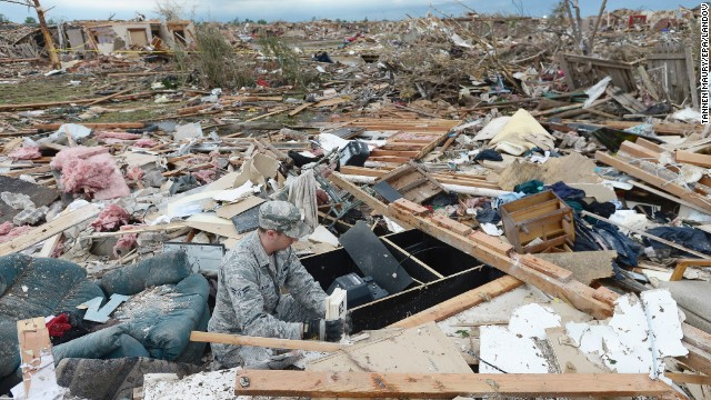 Air Force Airman First Class Justin Acord sifts through the rubble of his father-in-law's home on Tuesday, May 21, after a massive tornado ripped through Moore, Oklahoma, on Monday. The tornado was estimated to be at least 2 miles wide at one point as it moved through Moore, in the southern part of the Oklahoma City metropolitan area, <a  data-cke-saved-href='http://kfor.com/' href='http://kfor.com/' target='_blank' />KFOR reported. It was part of a tornado outbreak that began in the Midwest and Plains on Sunday, May 19. <a  data-cke-saved-href='http://www.cnn.com/2013/05/20/us/gallery/midwest-weather/index.html' href='http://www.cnn.com/2013/05/20/us/gallery/midwest-weather/index.html'>View more photos of the aftermath in the region.</a>