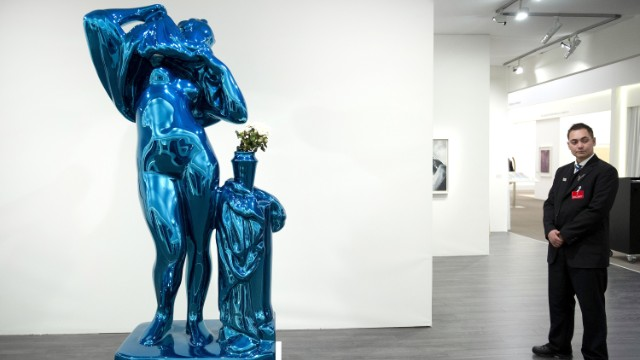 A security guard stands next to a sculpture by American artist Jeff Koons at <a href='http://www.TEFAF.com' target='_blank'>The European Fine Art Fair</a>, or TEFAF, on March 14. The fair takes place every year in Maastricht.