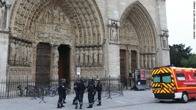 French police stand outside Paris' Notre Dame Cathedral on Tuesday, May 21, following the evacuation of the cathedral after a man shot himself dead in front of the altar. Historian and writer Dominique Venner killed himself in front of horrified tourists after denouncing same-sex marriage and immigration.