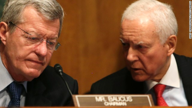 Sens. Max Baucus, left, and Orrin Hatch, co-chairmen of the Senate Finance Committee, confer during testimony in Washington on Tuesday, May 21, during a hearing regarding the targeting of conservative groups for extra scrutiny when they sought tax-exempt status by the IRS.