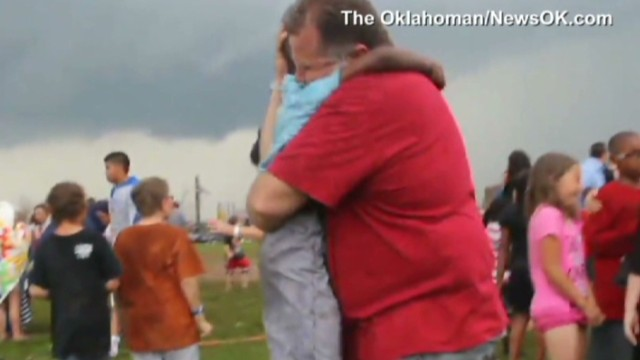 Neighbors comfort boy in tornado aftermath