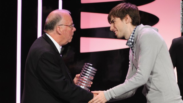 Steve Wilhite, left, receives a Webby Award from Tumblr's David Karp for his invention of the animated GIF format.