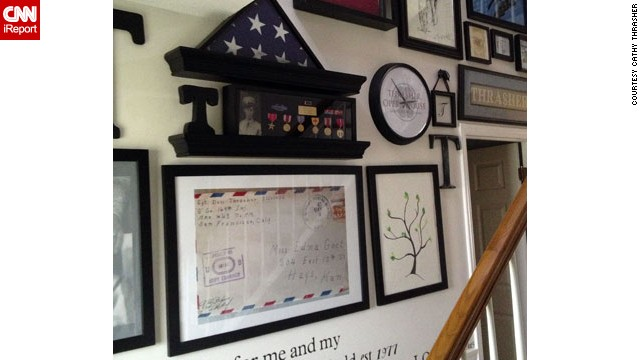 "<a href='http://ireport.cnn.com/people/Thrasher4031'>Cathy Thrasher</a>'s entryway is a gallery dedicated to the legacy of her family name. It includes a framed blowup of the envelope that delivered a love letter from her father-in-law to his future bride during WWII, personalized scripture and lots of military memorabilia. ""Thrasher is a word of strength and as our last name we cover every aspect of our personalities,"" Cathy writes."