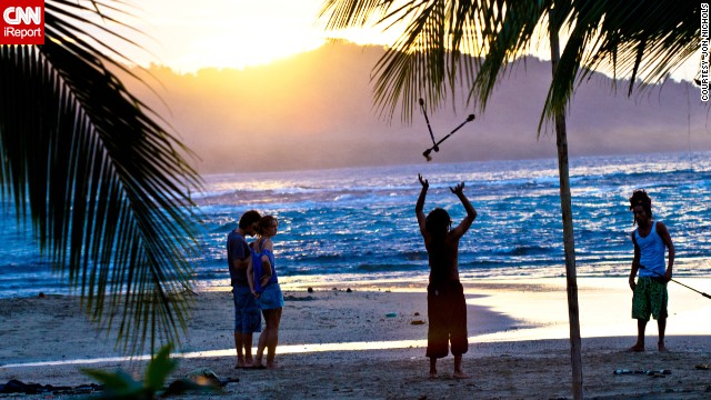 "Jugglers practice on the beach. ""I thought the <a href='http://ireport.cnn.com/docs/DOC-809299'>colors at this time of day</a> were magical,"" said Jon Nichols."