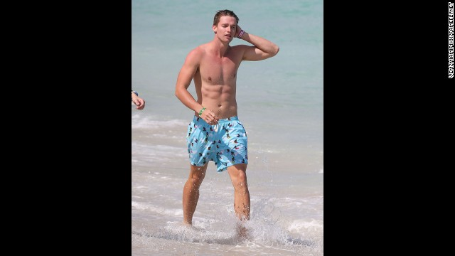 Patrick Schwarzenegger (son of Arnold and Maria) joined some friends in having a blast on the beach while on vacation in Miami in March 2013.