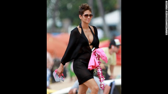 Mommy-to-be again Halle Berry headed to the beach in Hawaii with her fiance, Olivier Martinez, and her daughter, Nahla, in March.