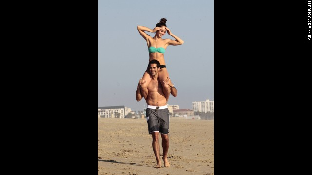 """Dallas"" actor Jesse Metcalfe gave his fiancee, Cara Santana, a lift at the beach in Santa Monica, California, in April."