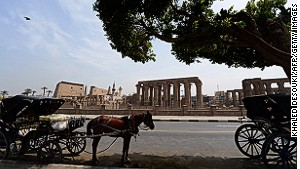 Horse-drawn carriages stand empty in Luxor, Egypt, the day after a hot air balloon explosion killed 19 earlier this year. The tragedy was one of a string of setbacks to the country\'s tourism industry.