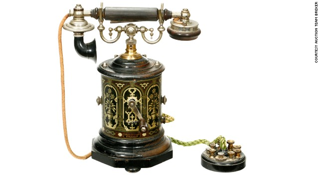 A 1905 L.M. Ericsson & Co. desk telephone known as the 'coffee grinder' for its circular shape and distinctive lithographed decoration.