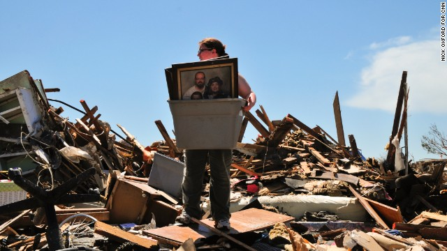Heather Shannon helps a friend find family photos and other keepsakes at her home in Moore, Oklahoma, on May 22. People who lost their homes to the tornado on Monday continue to search through the rubble in hopes of finding some of their belongings.