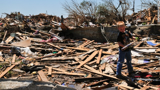 Aidan Fox, 9, was happy to find a baseball bat behind his grandparents' house in Moore on May 22.