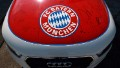 The logo of FC Bayern Muenchen is pictured on the hood of an Audi A1 during a promotional event at the Audi factory on August 21, 2010 in Ingolstadt, Germany. Luxury-car manufacturer Audi turned cars over to the players of FC Bayern Muenchen.