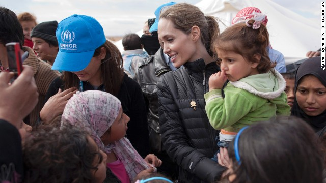 In this handout image provided by the United Nations High Commissioner for Refugees, Jolie meets with refugees at the Zaatari refugee camp outside of Mafraq, Jordan, in December 2012.