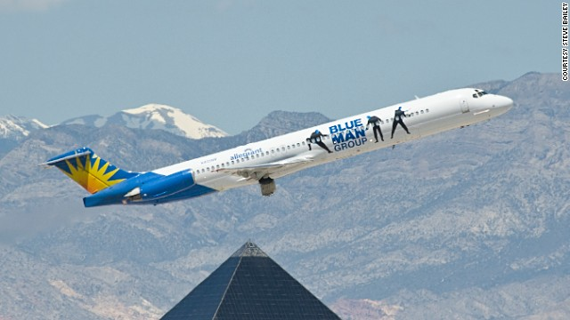 The Blue Man Group paint scheme on this MD-83 stands out well against the mountains near Las Vegas' McCarran International Airport.
