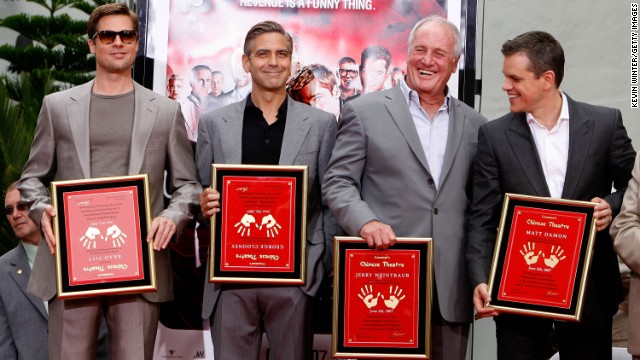 From left, Pitt, George Clooney, Jerry Weintraub and Matt Damon pose for a photo during their handprint ceremony on Hollywood's Walk of Fame in June 2007.