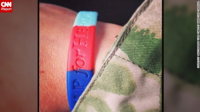 "Another British soldier, Chelsey Hampson-Carroll, wore her wristband, along with her camouflage gear, ""with pride."""