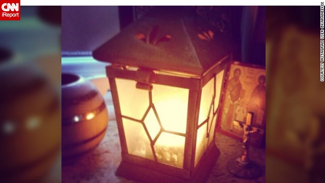 A simple lit candle placed in a lantern formed Marino Karanikki's tribute to the soldier killed Wednesday.