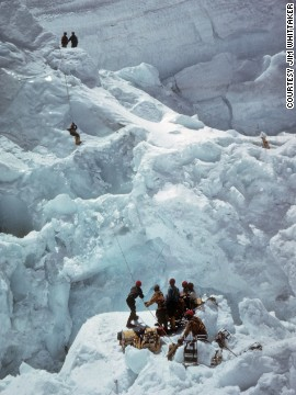 Climbers work their way through the dangerous Khumbu Icefall, a shedding glacier just after Everest base camp.