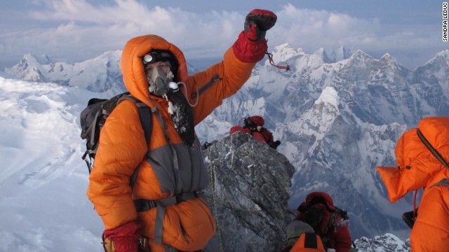 Sandra LeDuc captured this photo of a triumphant and relieved Jon Kedrowski reaching the summit of Mount Everest on May 26, 2012.