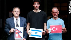 Nadav Ben Yehuda (center) and Aydin Irmak (rightt) with Israeli ambassador to Nepal, Hanan Goder-Goldberger -- all holding their respective flags.