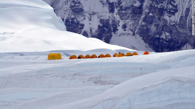 The tents from Camp 1 appear incredibly small against the backdrop of Everest.