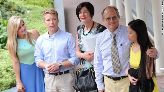 Shane Todd's family and his former girlfriend (far R) are pictured in Singapore on May 14.